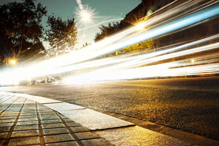 Fast moving cars at night time