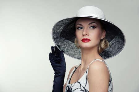Woman in hat retro portrait.