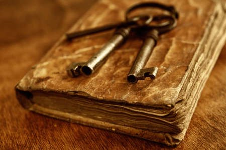 Old metal keys on vintage book