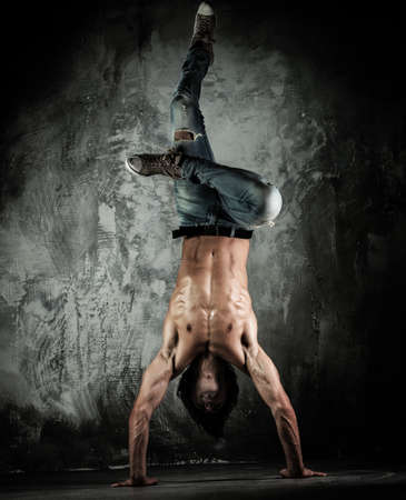 Young b-boy man with torso doing brake dancing movements