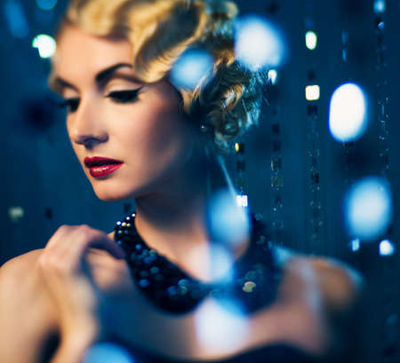 Elegant blond retro woman with beautiful hairdo and red lipstick (shallow DoF focus on lips)