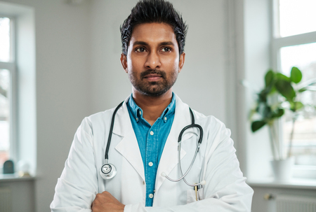 Photo for Indian doctor with stethoscope around neck in his office - Royalty Free Image