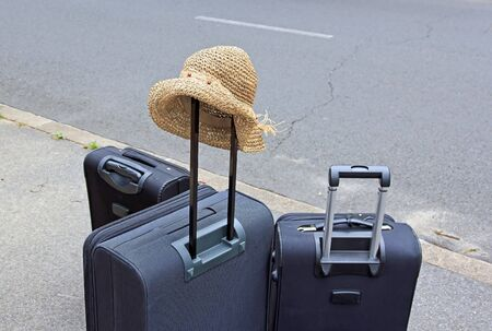 ready for the scheduled trip, hat and bags