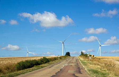 Small country road and wind turbines (Yonne, Burgundy, France)