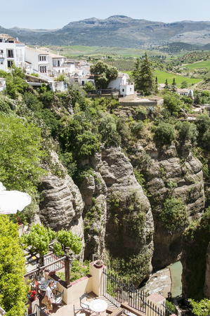 Ronda, Spain - May 6, 2014. Panoramic view from a new bridge in Ronda, one of the famous white villages in Andalusia, Spain