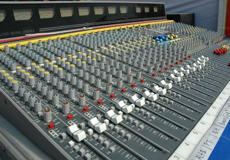 Audio mixing console in a recording studio. Faders and knobs of a sound mixer.