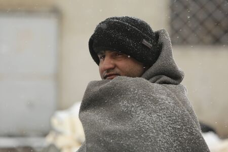 Belgrade, Serbia - January 10, 2017: Migrant mostly from Afghanistan and Pakistan, have occupied an abandoned customs warehouse in Belgrade in freezing temperatures waiting for a chance to move forward toward the European Union.