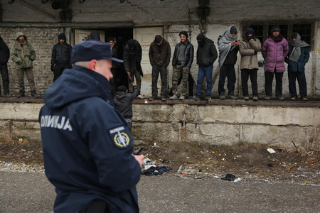 Belgrade, Serbia - January 17, 2017: Serbian Police guarded migrants. Migrant have occupied an abandoned customs warehouse in Belgrade as they seek ways to move to EU.