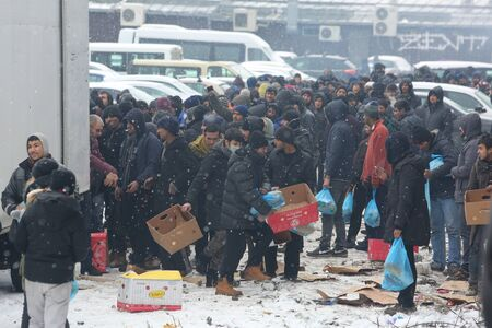 Belgrade, Serbia - January 18, 2017: Refugees in line for assistance from non-governmental organizations in Belgrade, Migrant mostly from Afghanistan and Pakistan in Belgrade they seek ways to move on toward Western Europe.