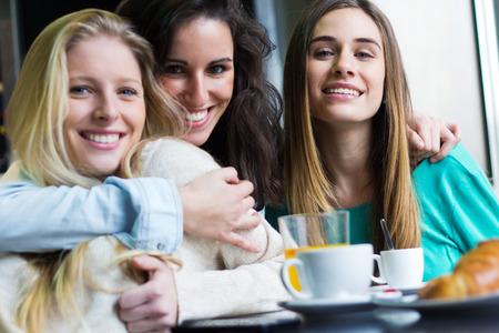 Portrait of Three young women having coffee break