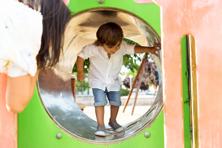 Portrait of the little boy having fun in the park.