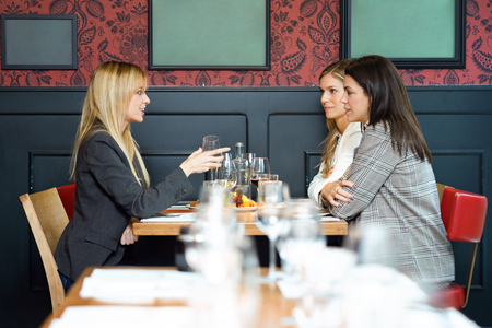 Shot of three pretty young business women talking while