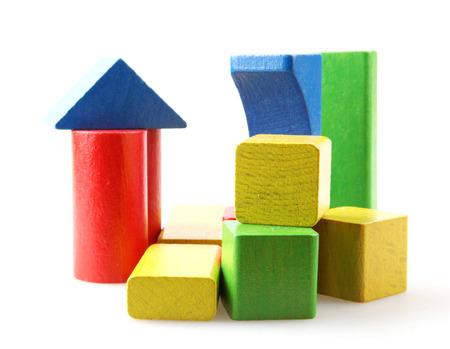 Photo pour Studio Shot Of Colorful Toy Blocks Against White Background - image libre de droit