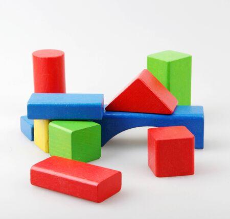 Photo pour Studio Shot Of Colorful Toy Blocks Against White - image libre de droit
