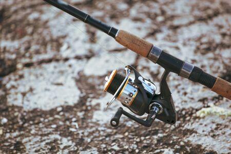 Photo pour Image of fishing rod with modern reel - image libre de droit