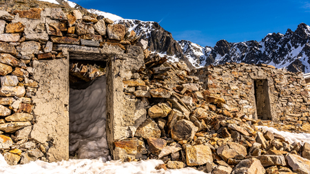 destroyed stone building in alps, france