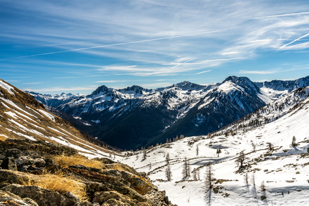 snowy mointain panorma in french alps, france