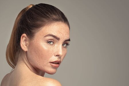 Photo for Beauty portrait of young attractive ginger woman with freckles on her face and body. Natural girl. Studio shot. - Royalty Free Image