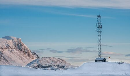 Communication mast in the mountains at the winter
