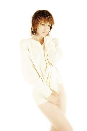 Young woman naked under white jumper - high keyの写真素材