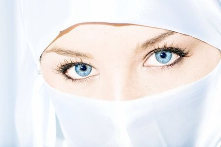 Blue eyed girl wearing face veil