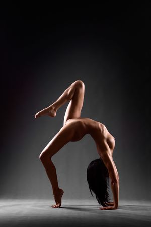 Art nude of gymnast in athletic pose