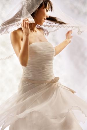 Bride dressing in white spins around happy