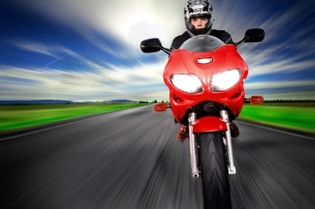 Photo pour Motorcycle moving very fast along motion blurred road - image libre de droit