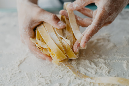 Photo for Closeup of process of making cooking homemade pasta. Chef make fresh italian traditional pasta - Royalty Free Image