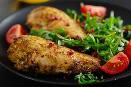 Photo pour Tasty grilled chicken breast with vegetables and salad served on dark table. - image libre de droit