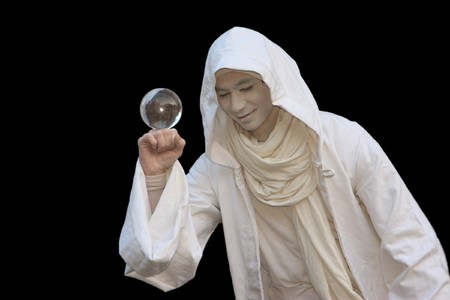 White Wizard manipulating Crystal balls isolated on black background.