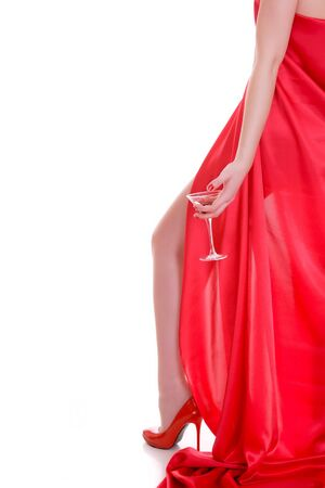 Attractive blond girl in red dress, studio shot