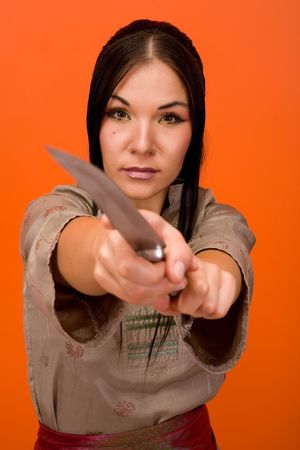 attractive brunette woman with knife