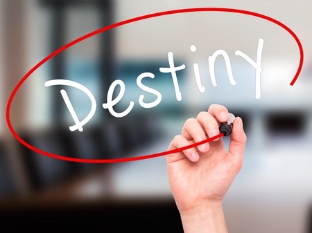 Man Hand writing Destiny black marker on visual screen. Isolated on office. Business, technology, internet concept. Stock Image