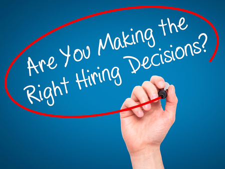 Photo for Man Hand writing Are You Making the Right Hiring Decisions? with black marker on visual screen. Isolated on background. Business, technology, internet concept. Stock Photo - Royalty Free Image