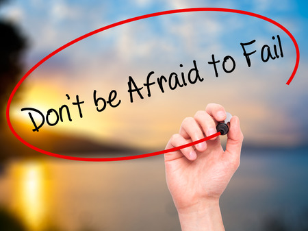 Man Hand writing Don't be Afraid to Fail with black marker on visual screen. Isolated on nature. Business, technology, internet concept. Stock Photo