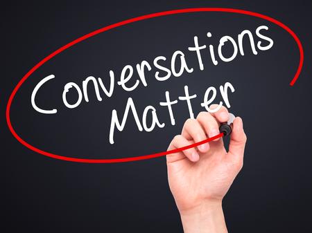 Foto für Man Hand writing Conversations Matter with black marker on visual screen. Isolated on black. Business, technology, internet concept. Stock Image - Lizenzfreies Bild