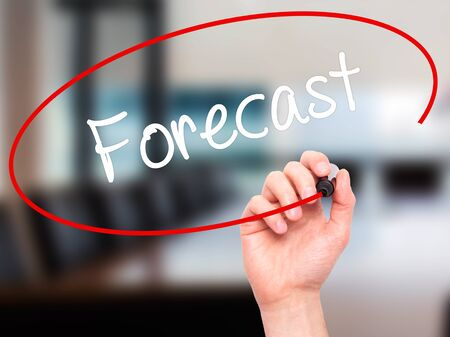 Man Hand writing Forecast with black marker on visual screen. Isolated on office. Business, technology, internet concept. Stock Photo