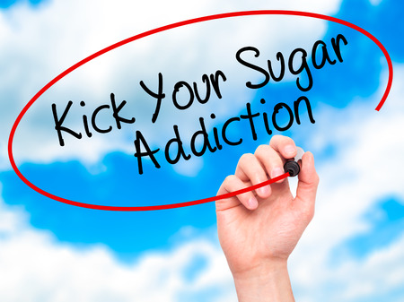 Photo for Man Hand writing Kick Your Sugar Addiction with black marker on visual screen. Isolated on sky. Business, technology, internet concept. Stock Photo - Royalty Free Image