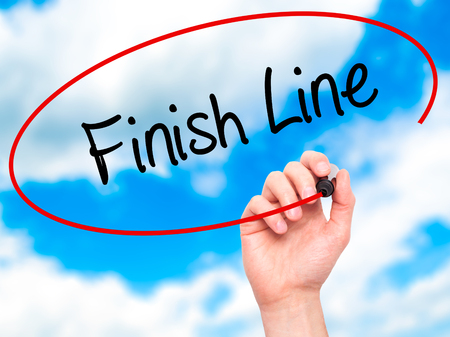Photo pour Man Hand writing Finish Line with black marker on visual screen. Isolated on sky. Business, technology, internet concept. - image libre de droit