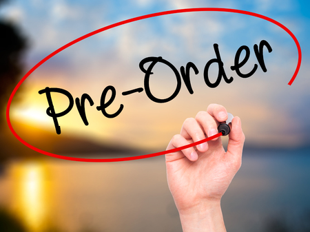 Man Hand writing Pre-Order  with black marker on visual screen. Isolated on background. Business, technology, internet concept. Stock Photo