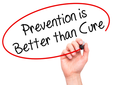 Man Hand writing Prevention is Better than Cure with black marker on visual screen. Isolated on white. Business, technology, internet concept. Stock Photo