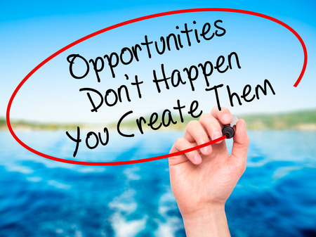 Photo pour Man Hand writing Opportunities Don't Happen You Create Them with black marker on visual screen. Isolated on background. Business, technology, internet concept. Stock Photo - image libre de droit