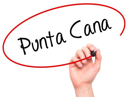Man Hand writing Punta Cana with black marker on visual screen. Isolated on white. Business, technology, internet concept. Stock Photo