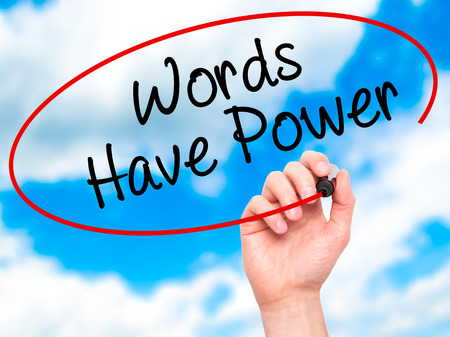 Man Hand writing Words Have Power with black marker on visual screen. Isolated on sky. Business, technology, internet concept. Stock Photo