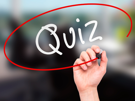 Photo pour Man Hand writing Quiz with marker on transparent wipe board. Isolated on office. Business, internet, technology concept.  Stock Photo - image libre de droit