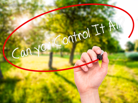Man Hand writing   Can you Control It All? with black marker on visual screen. Isolated on nature. Business, technology, internet concept. Stock Photo