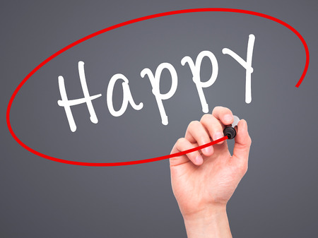 Man Hand writing Happy black marker on visual screen. Isolated on grey. Business, technology, internet concept. Stock Image