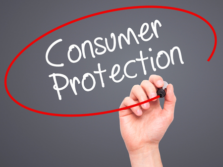 Man Hand writing Consumer Protection  with black marker on visual screen. Isolated on background. Business, technology, internet concept. Stock Photo
