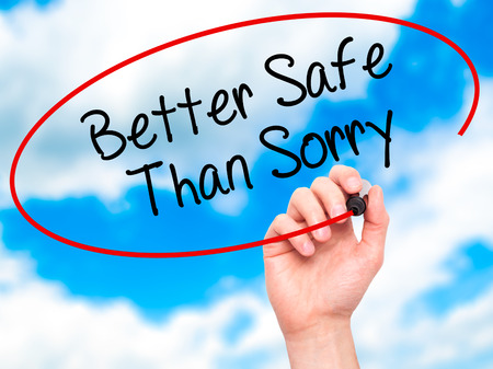 Photo for Man Hand writing Better Safe Than Sorry with black marker on visual screen. Isolated on background. Business, technology, internet concept. Stock Photo - Royalty Free Image